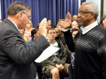 Superintendent Tom Seigel giving the oath of office to Warren Smith