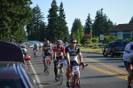 Cars of friends and family awaited their cyclists at Spanaway Middle School