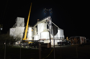 Cranes and crews work through the night to stabilize tanks at the Wilcox Feed Mill in Roy