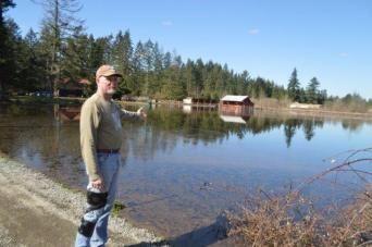 Steve Murray pointing out his flooded barn.